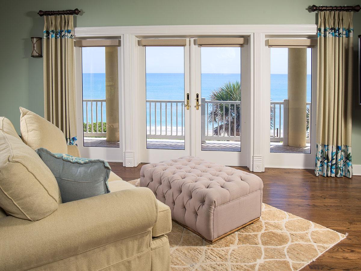 The master bedroom has an ocean front balcony